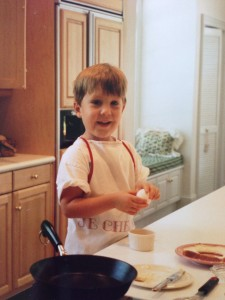 """Jackson at home cooking his favorite """"Tode in a Hole"""". He is now 24 and told me the other day he finally master the fine art of frying an egg."""
